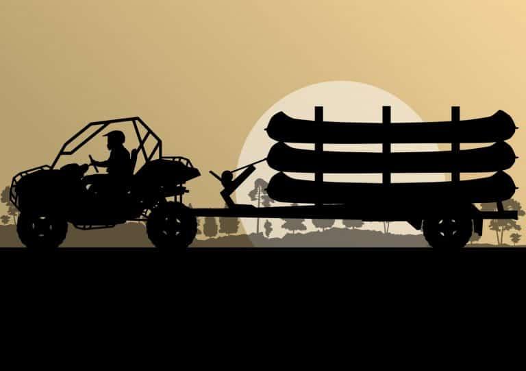 car pulling kayaks on a trailer
