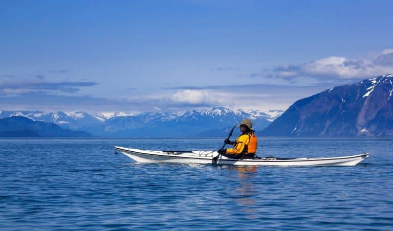 Female sea kayaker paddling in Glacier